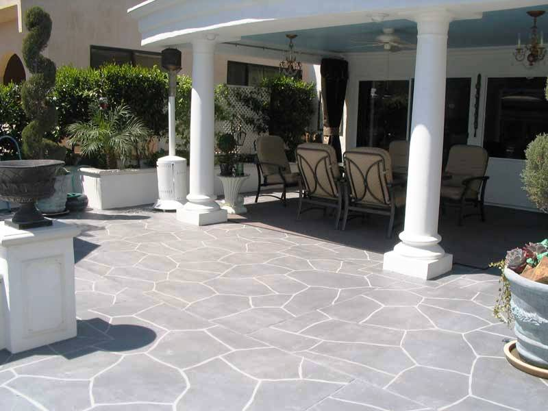 Concrete stained  patio with stencil pattern by Stone Medic