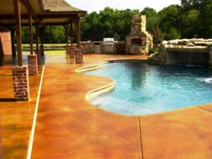 concrete overlay and staining on pool deck by Stone Medic